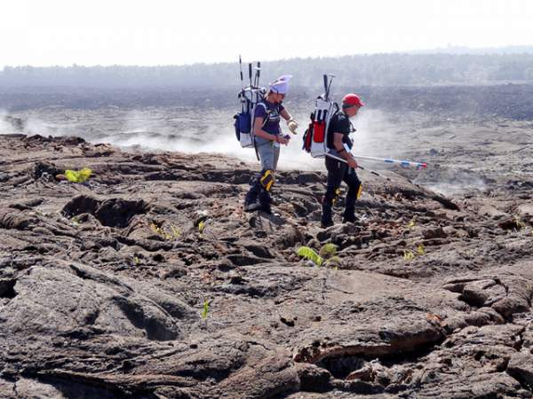 Simulation astronauts Darlene Lim and Rick Elphic, scientists with the NASA Ames Research Center, walk on Mauna Ulu. Photo courtesy of NASA