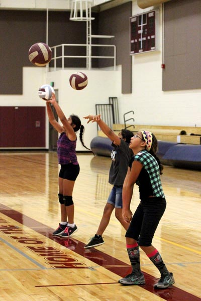 Girls participate in passing drills at the HI-PAL Youth Volleyball Clinic. Courtesy photo.