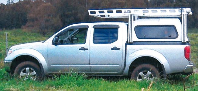 Police are looking for the worker's vehicle, which is a grey 2010 Nissan Frontier pickup truck, license plate 318 HDS. It has a white camper shell and aluminum racks.