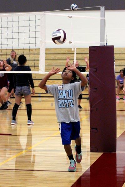 Jensen Navarro-Villa practices setting at the HI-PAL Youth Volleyball Clinic.Courtesy photo.