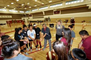 """UH-Hilo Vulcan Coach Tino Reyes demonstrates """"bump"""" form at the HI-PAL Youth Volleyball Clinic.Courtesy photo."""