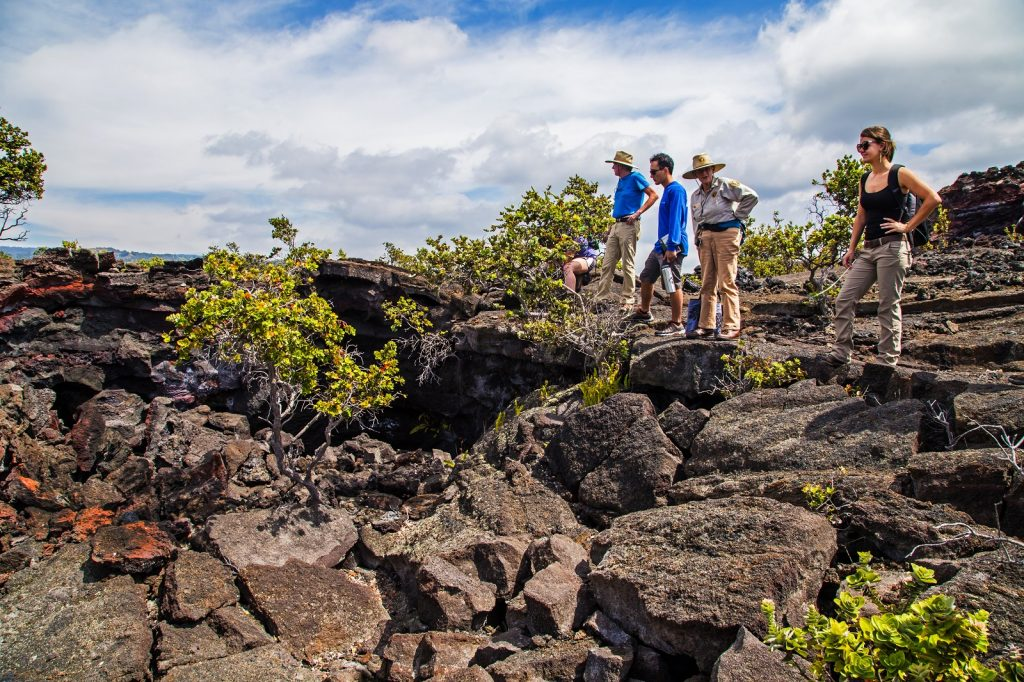 Visitors enjoy a guided hike to Pu'ū o Lokuana cindercone. NPS photo/Janice Wei