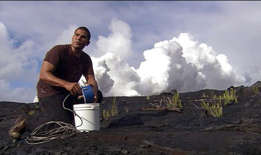 Milton Garces deploying an infrasonic microphone at Kīlauea, 2006. University of Hawai'i Infrasound Laboratory.