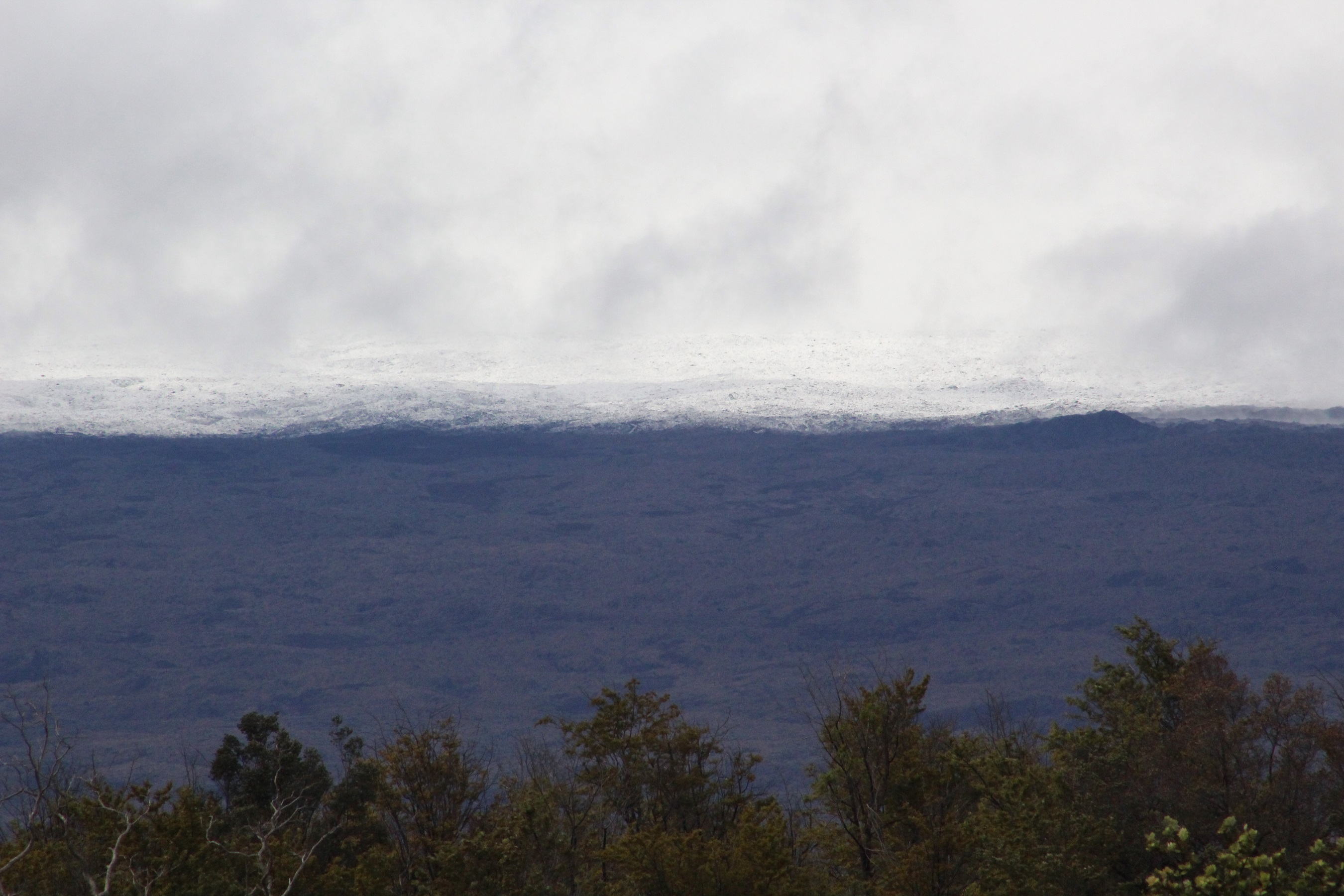 Visitors at Volcanoes National Park's Jaggar Museum were treated periodically with views of snow-capped Mauna Loa on Dec. 1. NPS photo.