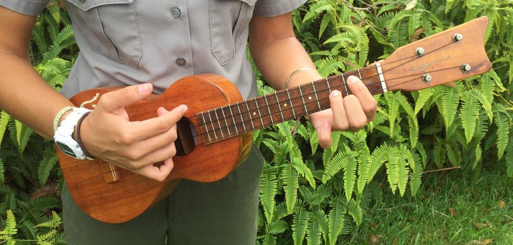 Ranger strumming 'ukulele. NPS photo.