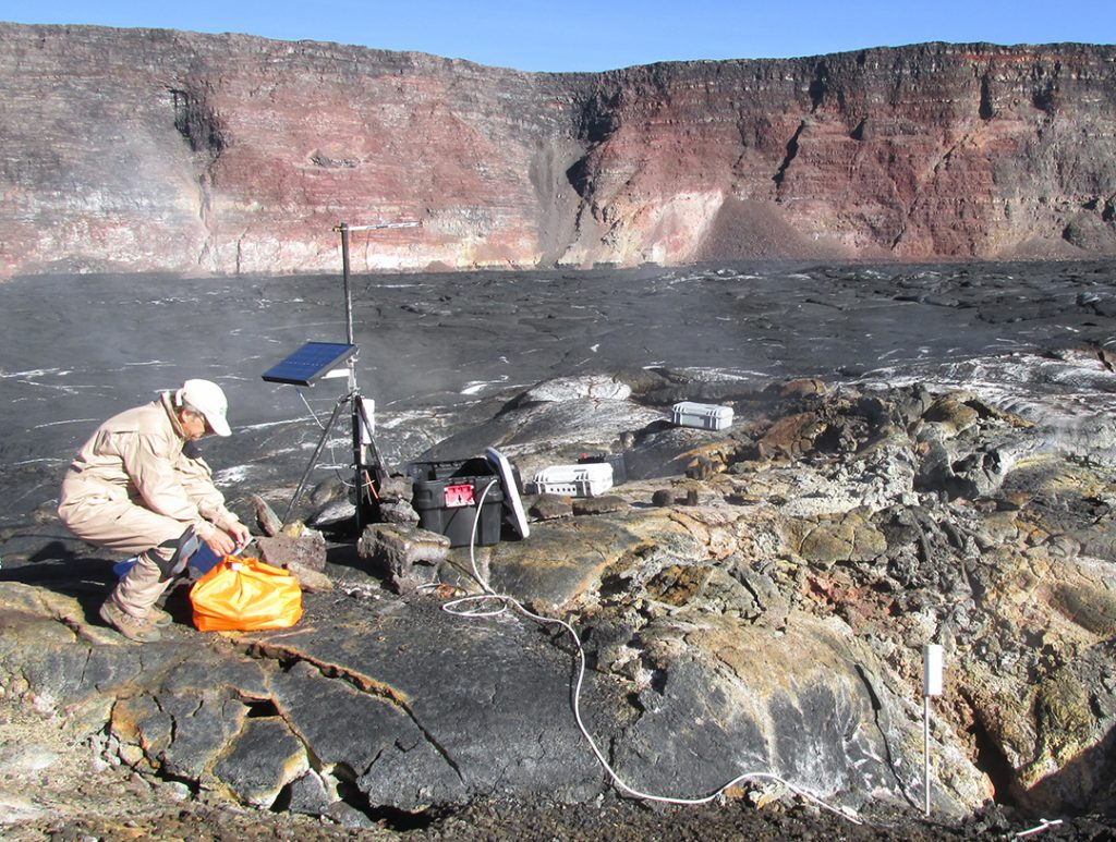 Hawaiian Volcano Observatory scientist monitoring gas emissions on Mauna Loa in 2015. USGS photo.