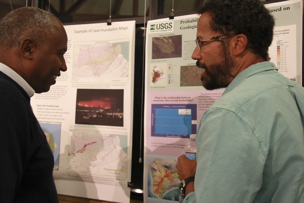 USGS Hawaiian Volcano Observatory geologist Frank Trusdell (right) discusses methodologies for lava flow hazard assessment in Hawaii with a volcanology colleague from Ethiopia during the recent Volcano Observatory Best Practices Workshop in Vancouver, Washington. Eruptions in the East African Rift bear some broad similarities to Hawaiian volcano rift zone eruptions. USGS photo.
