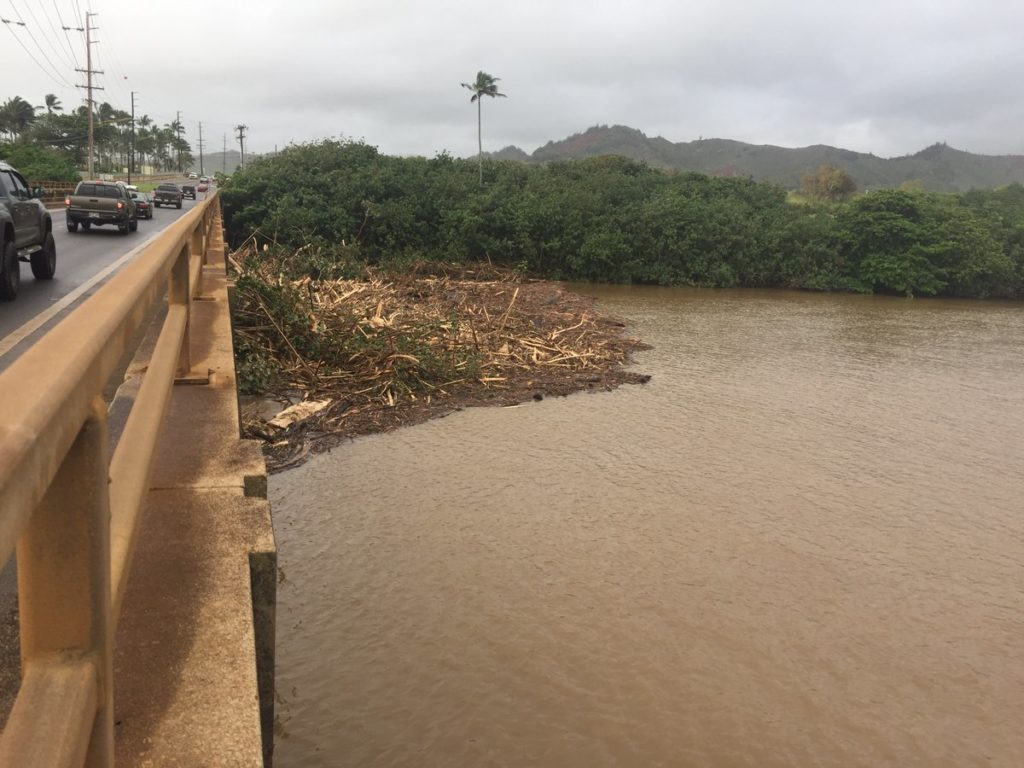 April 16, 2018: Hawaii DOT crews are continuing clean up and inspections after the #kauaiflooding. This picture shows flood debris from Wailua River against the southbound supports of Kuhio Highway. @DOTHawaii