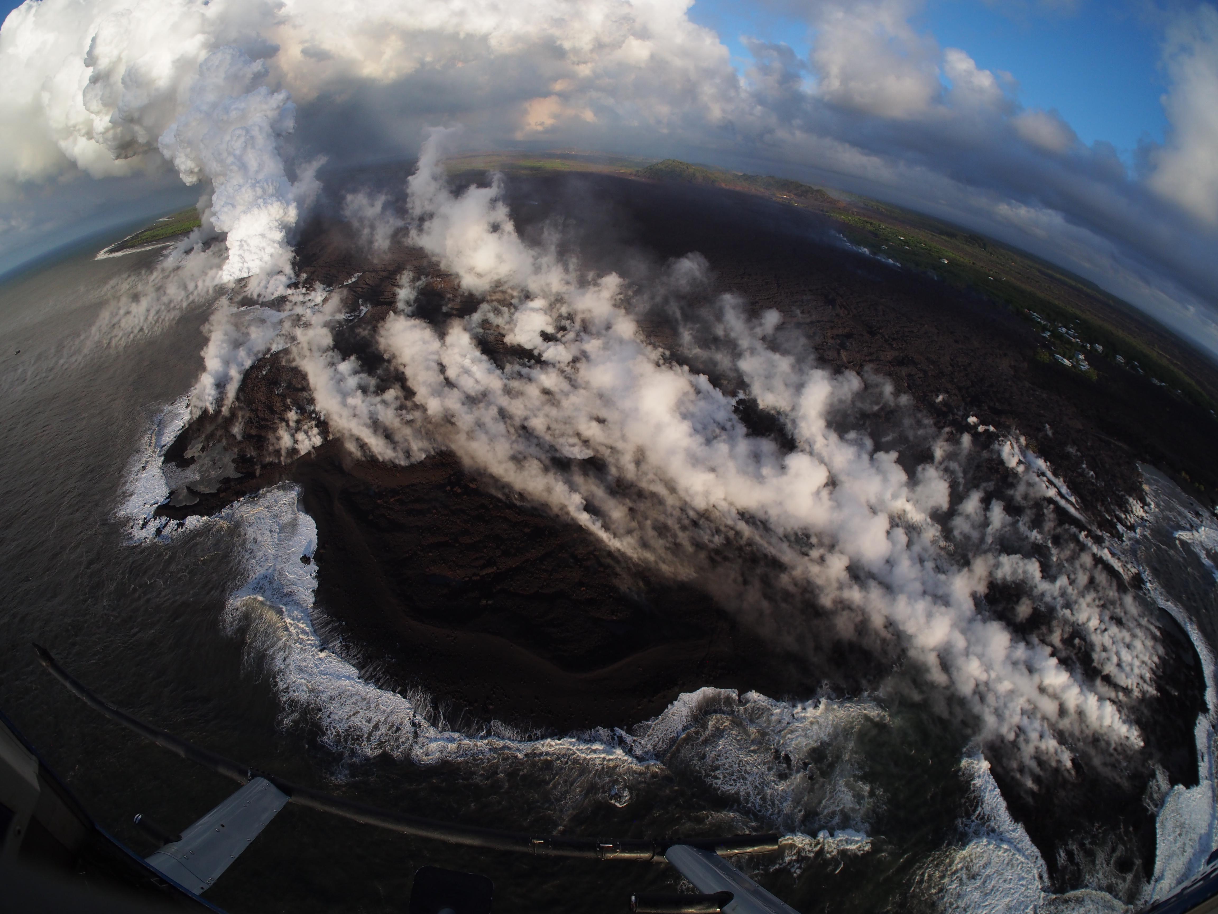 Lava flow from Hawaii volcano engulfs neighborhood, creates new land