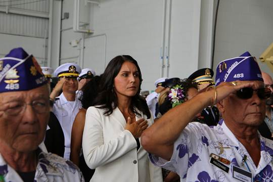 Rep. Gabbard pays respect to the remains of service men killed in the Korean War. PC Rep. Gabbard