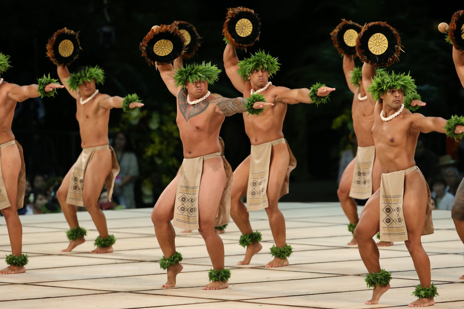 The men of hālau Ke Kai O Kahiki at 2013 Merrie Monarch