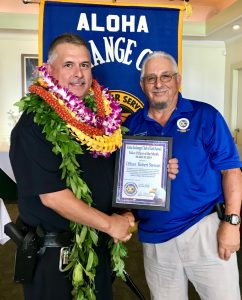 Officer of the Month Officer Robert Stewart John Stewart (father) presenting the award. PC: Hawaii Police Department, April 2019